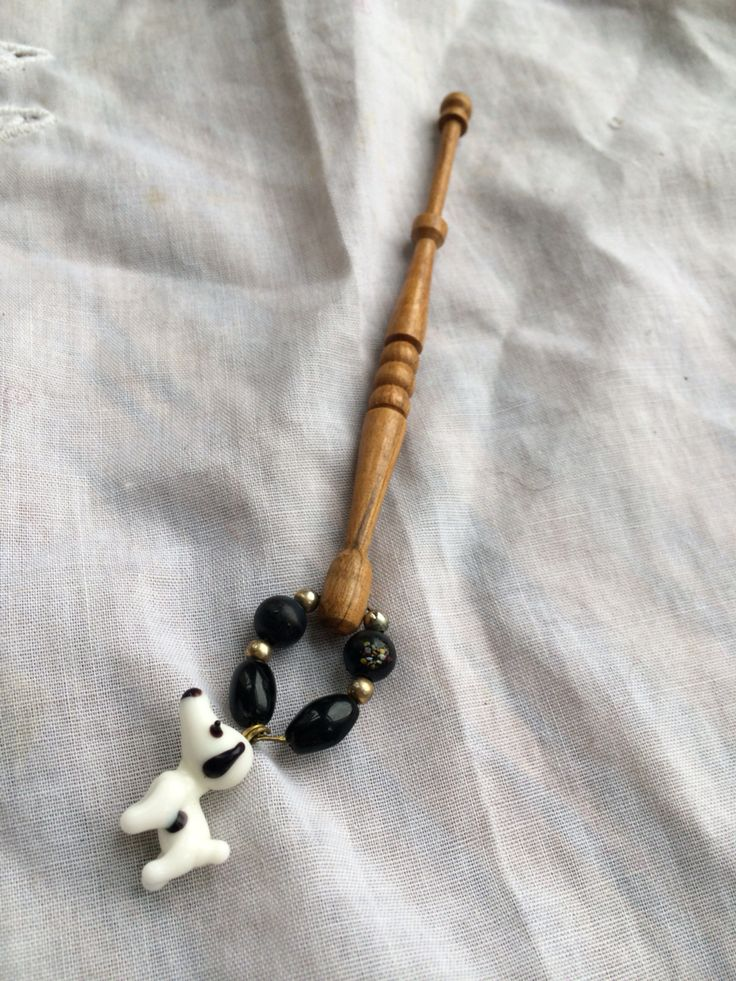Wooden bobbin with dog spangle
