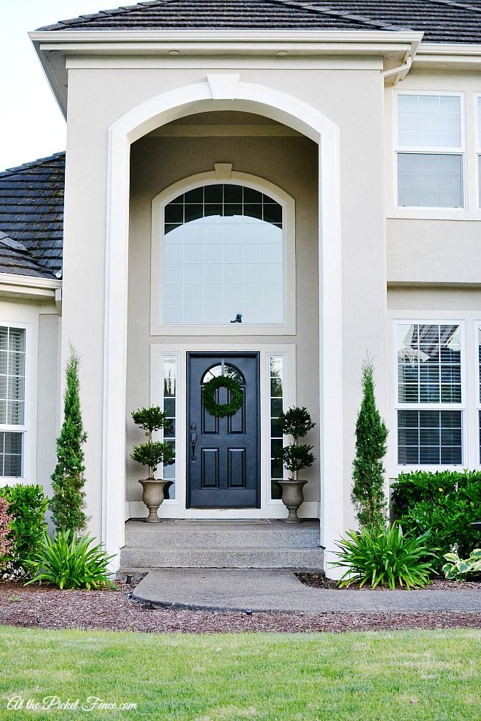 Stucco exterior- creme paint with white trim and a very dark color (black, olive) for door and shutters