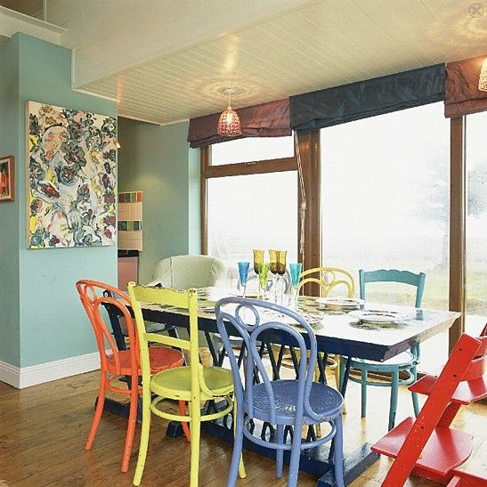 Love the zest of painted antique mix of chairs.