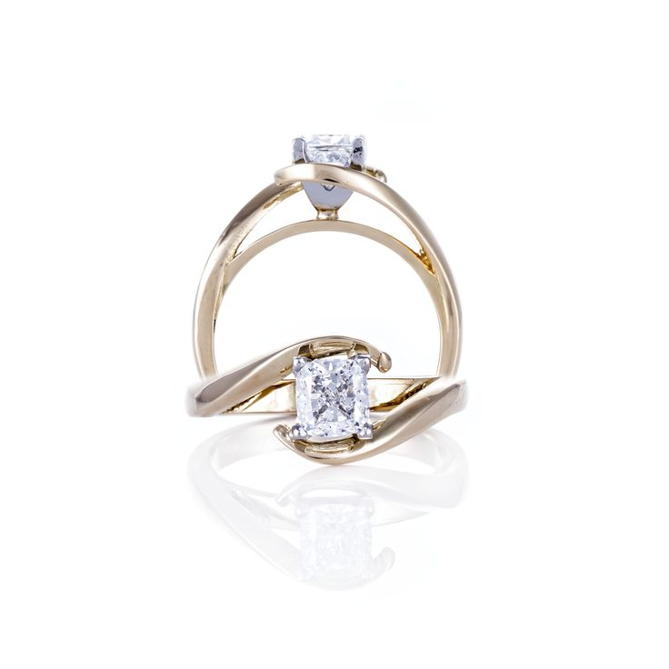 Twisted band cushion cut engagement ring