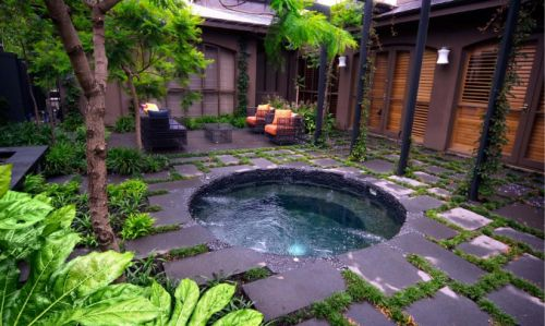 In ground hot tub that I am sure you could keep cool for the summer as a dipping pool.   Great for small city backyards!