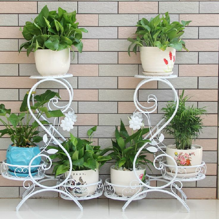 http://pt.aliexpress.com/item/European-Antique-Flower-Shelf-Wrought-Iron-Multilayer-Indoor-Pot-Frame-Folding-Money-Plant-A-Hollow-Floor/32475669289.html