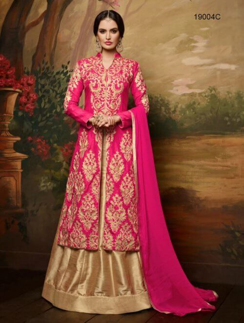 This gorgeous set features a pink banglori silk kurta with heavy embroidery. It comes with beige banglori silk lehenga and a matching dupatta. This set can be customized upto bust size of 42 inches. *Call / Whatsapp / Viber : +91-9052526627  *Email : customercare@natashacouture.com  *Worldwide Shipping | Free shipping in India | Cash on delivery *