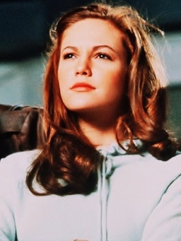Cherry from The Outsiders. (Diane Lane) I loved her hair in this.
