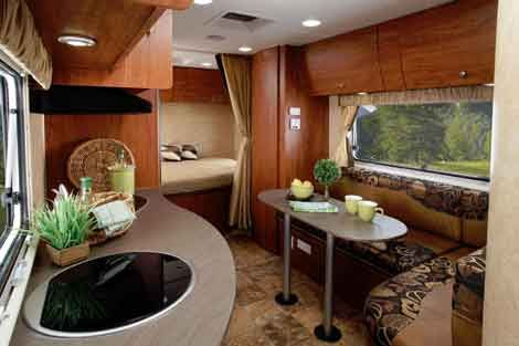 Ultra lite travel trailers equal half the weight and twice the fun! See what all the fuss is about as I discuss advantages, construction, special features, and green RV designs.