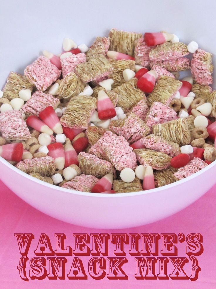 Valentine's Snack mix courtesy of makebakecelebrate blog: strawberry shredded wheat, Cheerios, white chocolate chips, mini marshmallows, and valentine's candy corn