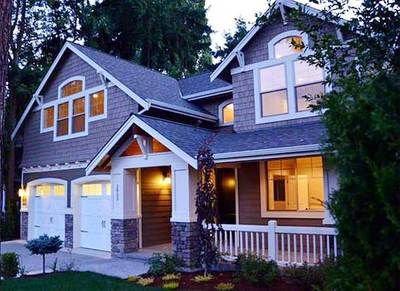 <ul><li>Shakes, stone and an interesting window arrangement give this Craftsman home plan a unique look.</li><li>Double doors off the foyer open to a quiet den with views that face front.</li><li>The kitchen enjoys a huge island that adds extra counter space.</li><li>From the island you can see the fireplace in the great room, thanks to the open floor plan.</li><li>A covered patio extends across the whole width of...