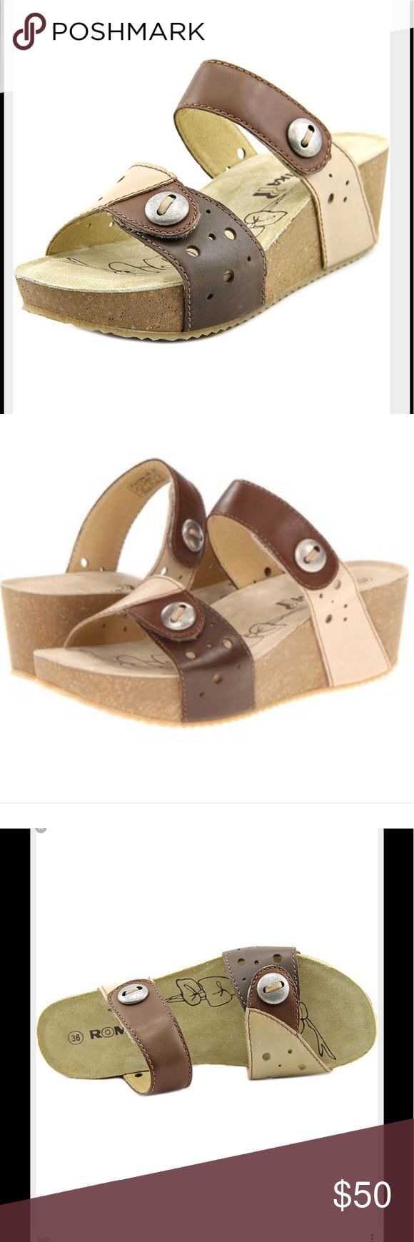 Romika Florida 06 Open Toe Cork Wedge Sandals New without box, Premium vegetable-dyed leather upper in a slide sandal style features color blocking, perforations and silver-tone button embellishments. Adjustable Velcro closures allow for easy on-and-off wear and a secure fit. Leather-lined footbed. Cork midsole offers support, stability and custom comfort as it conforms to your foot over time. Hardwearing and lightweight PU outsole delivers long-lasting durability. Measurements: Heel Height…