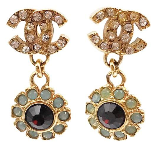Chanel Gold Plated CC Red and Opal Crystal Flower Piercing Earrings. Free shipping and guaranteed authenticity on Chanel Gold Plated CC Red and Opal Crystal Flower Piercing EarringsChanel Gold Plated CC Red and Opal Crystal Flower ...