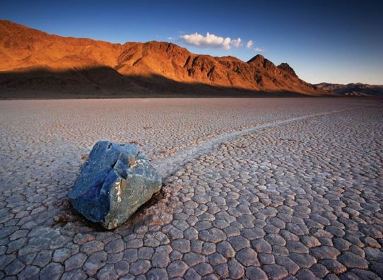 "Racetrack Playa in California is well known due to its sailing stones. No one knows how, but the stones there somehow manage to move from their original position, leaving a track behind them. The reasons are still unknown and are subject of research. It is supposed that the winds in the valley are ""responsible"" for this."