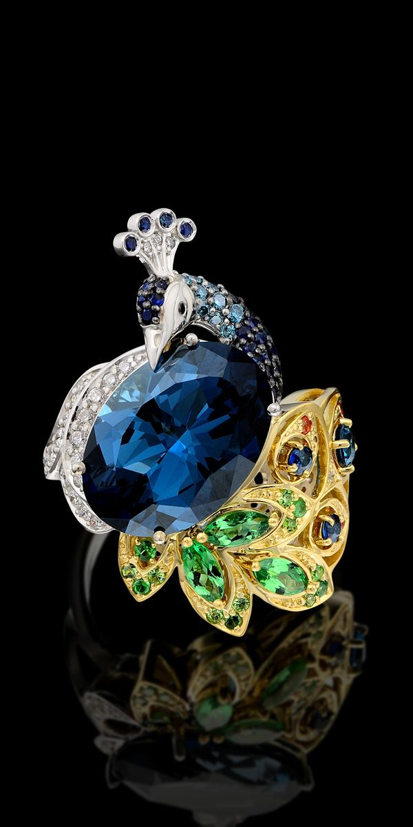 Ring 11914 Collection: Birds of paradise  18K yellow and white gold, topaz  London blue 10,54 ct, diamonds, black diamonds, blue diamonds, blue sapphires, colored sapphires, tsavority, demantoids enamel.  Set:  Earrings 11912