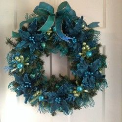 Peacock theme handmade Christmas wreath.  Other peacock Holiday items include garland, decorations, ornaments, tree toppers, invitations, cards and more.