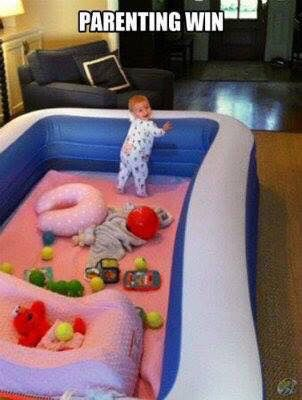 Get a large cheap blowup swimming pool 3 ft high. Perfect large playpen for baby!