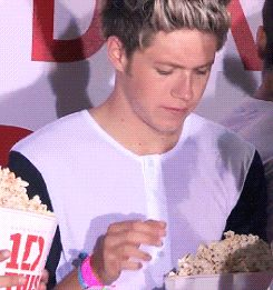 Niall sniffed the popcorn at the photoshoot to make sure it was real before he ate it! haha (GIF)>>this is why we are getting married
