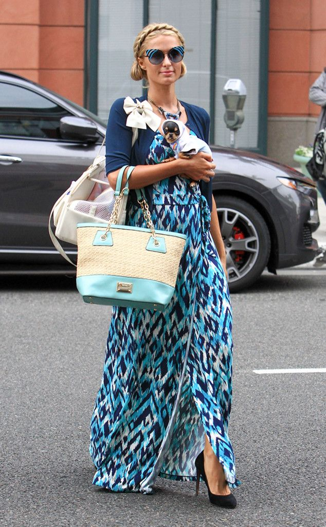 Paris Hilton matches her maxi dress to her stylin' cat-eye inspired sunnies & we love it!