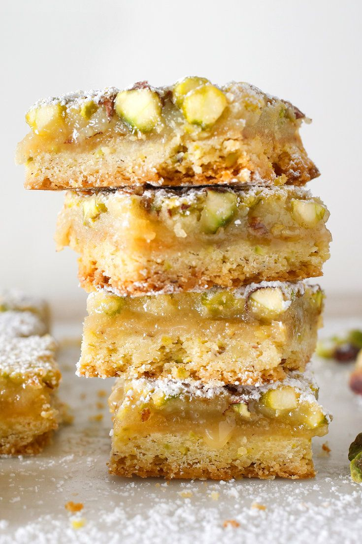 Pistachio Lemon Bars by cooking.nytimes: These delightful and easy lemon bars have everything the traditional ones do – tang, sweetness and a buttery base – plus the added benefit of pistachios folded into the filling and the crust. #Bars #Lemon #Pistachio