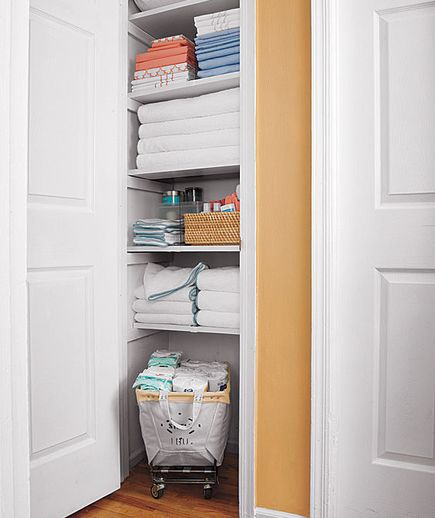 Organized linen closet Particularly like the rolling bin on the floor.  All sorts of possibilities for that. Real Simple Magazine