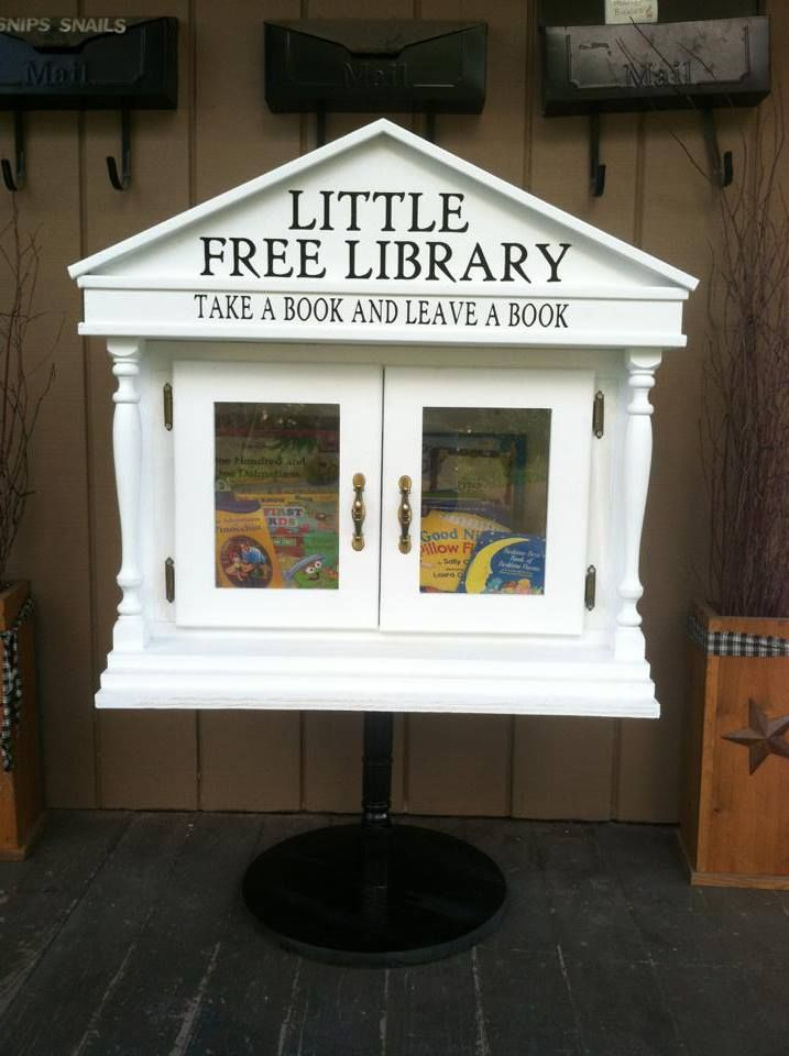 Lori McGraw. Bainbridge, NY. This little free library is located at Snips & Snails Children's Consignment store in a small town in upstate NY. It was built with love so all the children visiting can take a book home with them. No child should ever be without a book at home. It has become very popular and families are loving the idea!