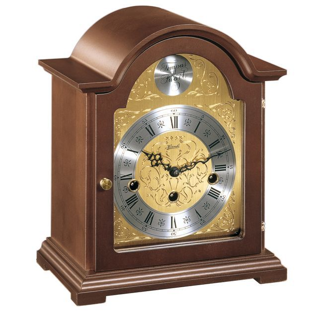 Hermle BETHNAL Mantel Clock 22511-030340 traditional style bracket clock is made of selected hardwoods with walnut finish & displays an elegant etched dial.