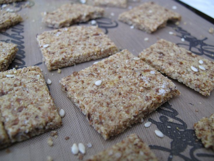 """Raw """"Wheat Thins"""" (Vegan, Gluten-Free, Sugar-Free, Raw)  these helped use up leftover pulp from making almond milk and taste delicious! The flavour is pretty neutral, just like wheat thins, so they are great for loading on tasty toppings :)    1 cup packed dry almond pulp (from making almond milk with 1 cup almonds)  2"""