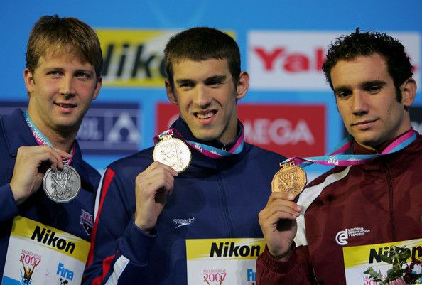 Michael Phelps Photos Photos - (L-R) Silver medalist Ian Crocker of the United States of America,  gold medalist Michael Phelps of the United States of America and bronze medalist Albert Subirats Altes of Venezuela pose on the podium following the Men's 100m Butterfly Final during the XII FINA World Championships at the Rod Laver Arena on March 31, 2007 in Melbourne, Australia. - XII FINA World Championships - Day 15