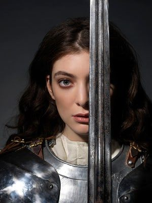 Lorde in armour, carrying a sword