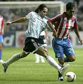 Argentina 1 Paraguay 0 in 2007 in Barquisimeto. Gabriel Milito and Aldo Bobadilla battle for the ball in Group C at Copa America.