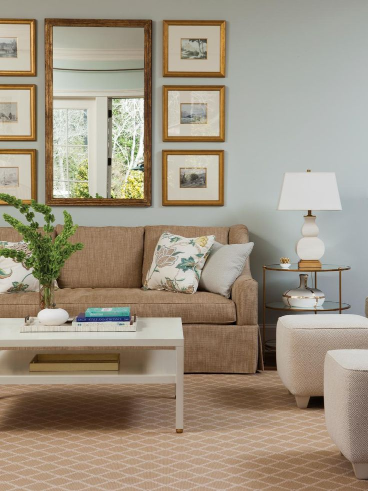 Light blue walls are paired with neutral furniture and accessories for a light, airy living room. To add visual interest to the neutral furnishings, a variety of textures and patterns is used.