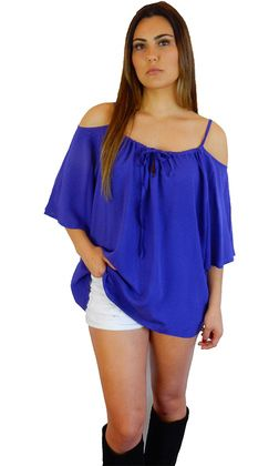 Tallow Top by SAN JOSE features gorgeous cold shoulder detailing with adjustable straps. The women's top has a tie string front and a hemline that comes down to approximately the mid thigh. Available in white and cobalt.