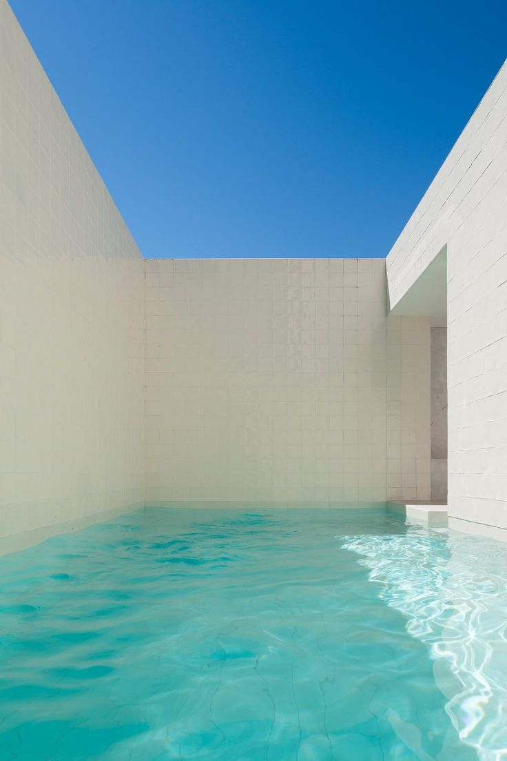 """House in Alfama, Portugal by Matos Gameiro Arquitecto, is a renovation of  one of the few medieval structures in the area.  In the most dramatic moment a pool covers the entire courtyard area. This """"room of water"""" gives reference to an ancient bathing culture rarely embraced in modern times."""