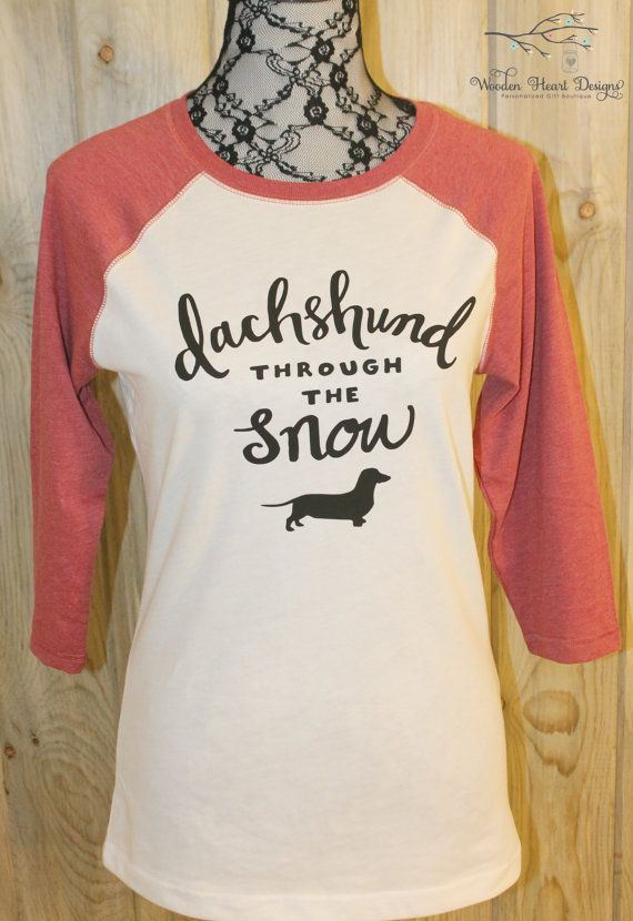 Dachshund Through the Snow, with one short legged dog! Show your holiday spirit with this adorable Christmas shirt. Here at Wooden Heart Designs were