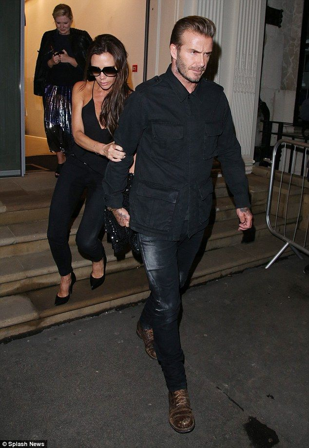 Somebody to lean on! Victoria Beckham clung on tight to her husband David Beckham as they ...