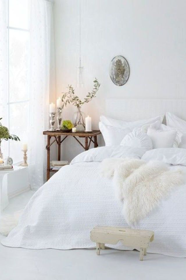Add a fur throw to your bed, couch or kitchen chairs for a tactile element of luxe.