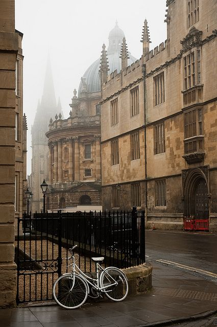 Catte street in fog, Oxford by kamshots on Flickr.  enchantedengland: If you are fortunate enough to go walkabout in Oxford this is a street you mustn't miss: the ancient, almost painfully beautiful Catte Street. This otherworldly lane passes alongside Radcliffe Square for a look at the Radcliffe Camera; and just opposite that a view of the Bridge of Sighs to your left, on New College Lane.