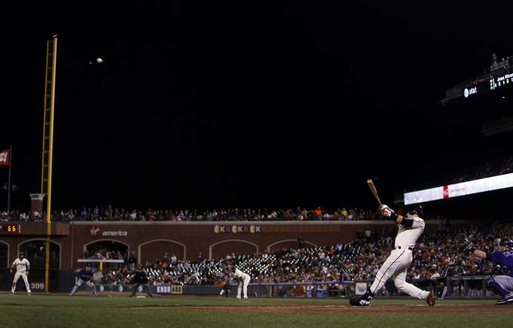 Buster Posey hits the game-winning two-run home run in 9th inning against the Colorado Rockies on August 27.
