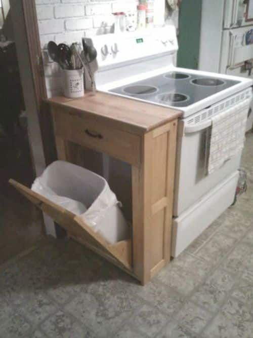 #27. Make a DIY garbage can cabinet and cutting bo…