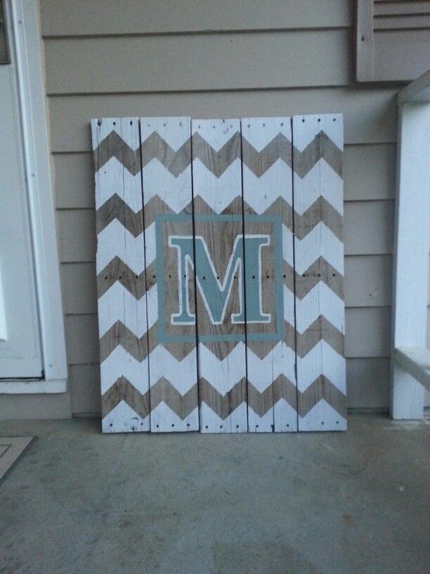 Front porch decor I made from old pallets. Can't get enough of the chevron pattern!