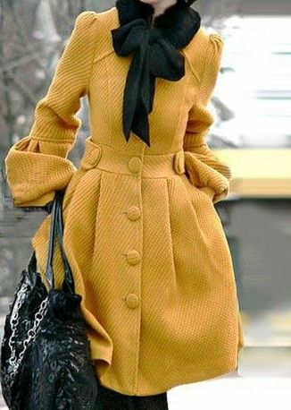 Mustard yellow coat and a cute bow scarf