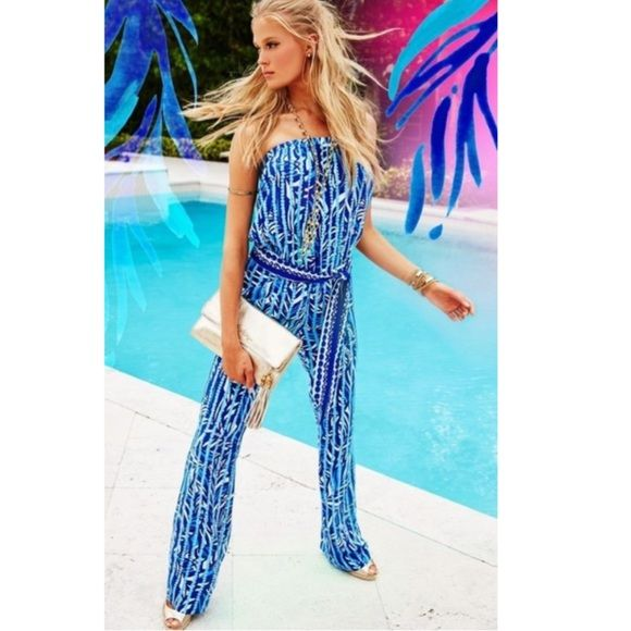"""Lilly pulitzer Tia Strapless Jumpsuit, Size XS NWT Trades Lilly pulitzer New with tags Santorini print 2015 Gorgeous !!                                                  printed blouson jumpsuit with tie waist detail  oStrapless  oSelf tie blouson waist  oPull-on style  oAbout 42"""" from bust to hem  oInseam, about 32""""  oRayon  oImported Lilly Pulitzer Pants Jumpsuits & Rompers"""