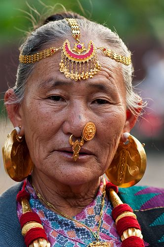 Woman with traditional ornamentsA Limbu woman from east Nepal in her traditional ornaments.