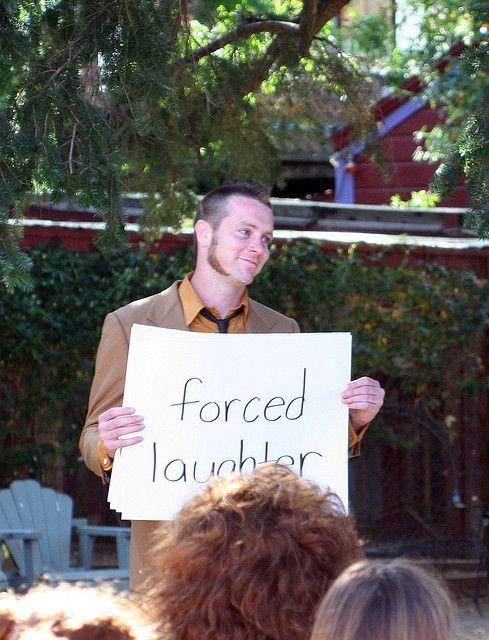 Such a great idea: wedding cue cards! A groomsman helped the guests by holding up helpful/hilarious cue cards during the ceremony.