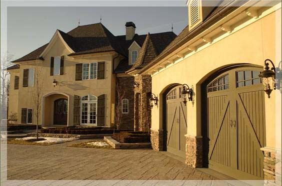 Great carriage house style garage doors not sure of the for Beautiful garage doors