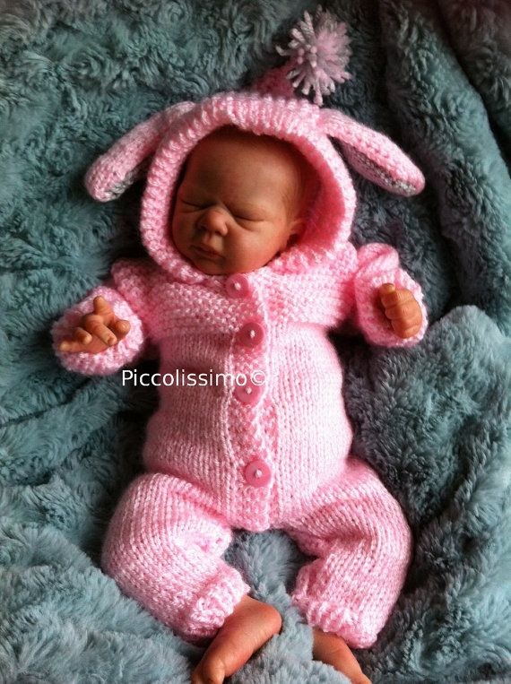 This 12 bunny all-in-one knitting pattern is really cute and designed by me. It will fit most 12 baby dolls and reborns.  You will need: Materials: 25g 4 ply baby yarn oddment of gray yarn for ears 4 tiny buttons 4 bows needle for sewing knitting needles 10/3mm  This is a digital file