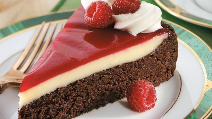 Serve this wonderful raspberry-glaze chocolate dessert topped with whipping cream – a delicious treat.