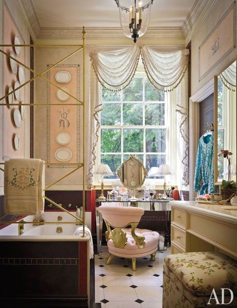 """I wanted a little sparkle, not over the top, but lush, exotic—a glamorama."" The elegant new space features a dressing table with an ornate antique mirror and a tufted pink slipper chair."