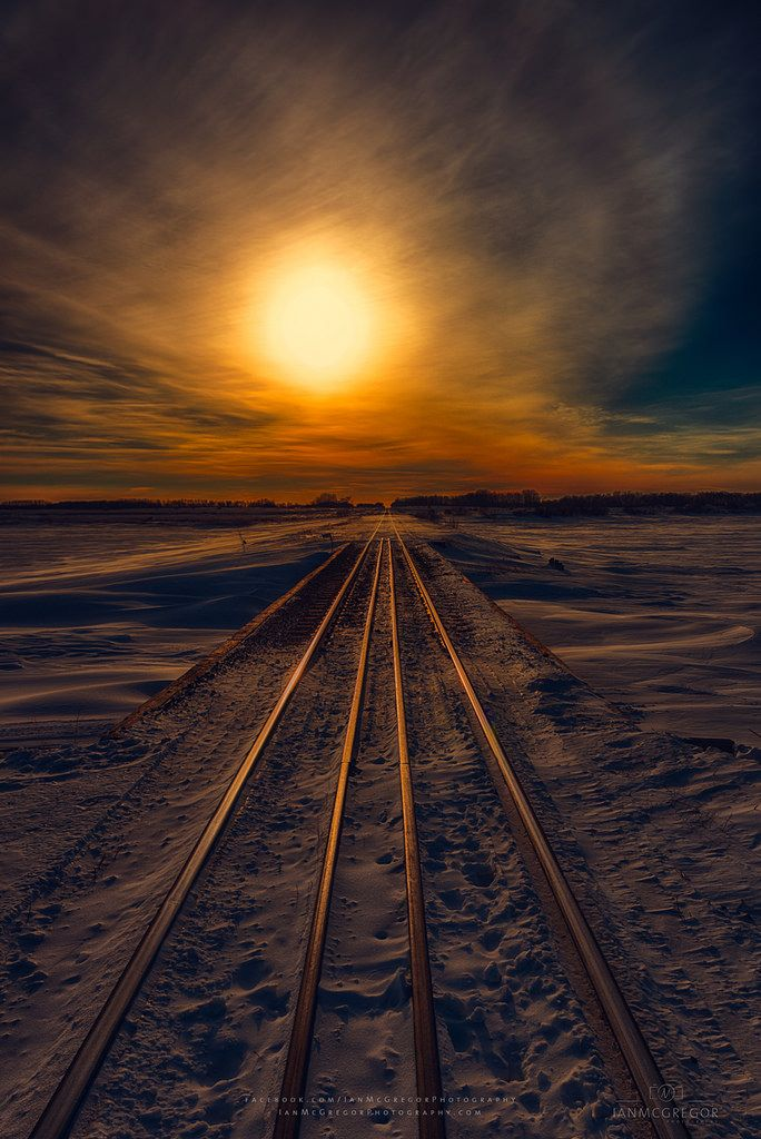 ~~Journey to Sunset | setting sun glows upon the cold steel in this frozen wonderland, Yorkton, Saskatchewan, Canada | by Ian McGregor~~