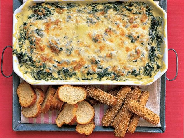 Hot Spinach dip-This rich, creamy dip can be assembled through step two up to three days ahead, then covered and refrigerated; it can also be served as a side dish. Two 10-ounce packages of frozen spinach can be substituted for the fresh. Thaw according to box instructions, drain well, and chop.