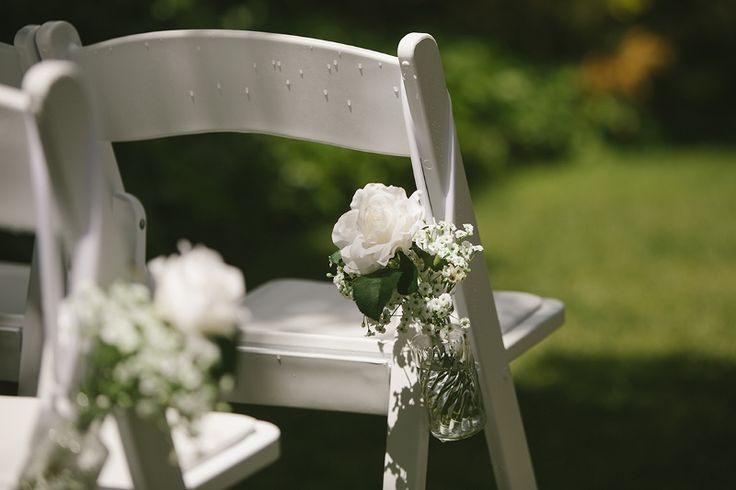White folding chairs for ceremonies @ Chateau Dore Winery.  Photography by www.lizarcus.com