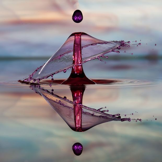 A picture of a water droplet taken at a fast shutter speed titled 'Five Drop Collision'