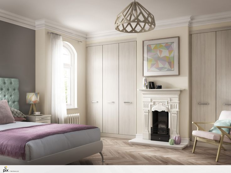 Pastel Pantone inspired bedroom, with mid century style. Sofa oak fitted wardrobes work well within the alcoves of this Victorian style bedroom. Cast iron fireplace gives a vintage feel, mixed with the geometric parquet flooring. Scandinavian detailing mixed with traditional design. Bedroom decor idea by http://www.setvisionspix.co.uk/